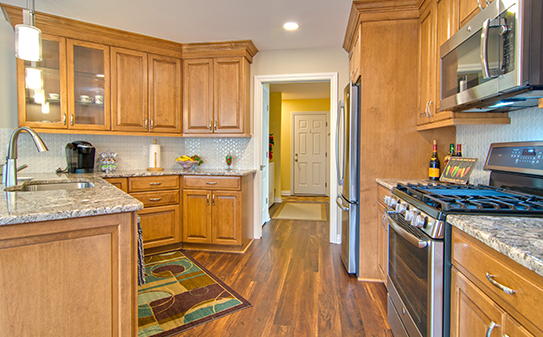 beautiful remodeled contemporary kitchen with stainless appliances.