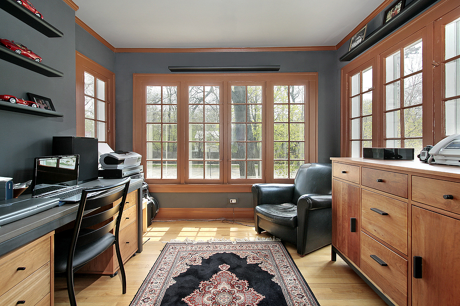 Home office with wall of windows around room